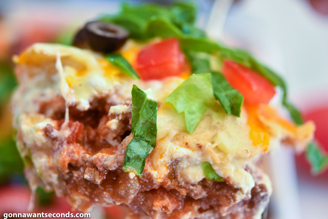 A close up slice of taco casserole
