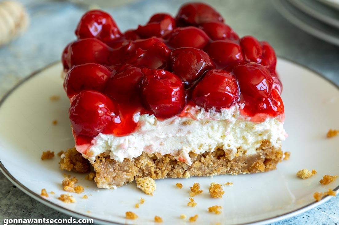A slice of Cherry Delight recipe on a dessert plate