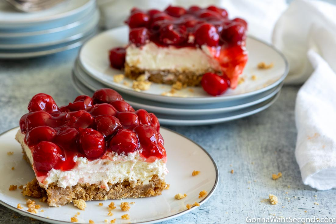 Two slices of Cherry Delight recipe on dessert plates