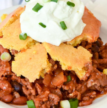Chili cornbread casserole topped with a dollop of sour cream