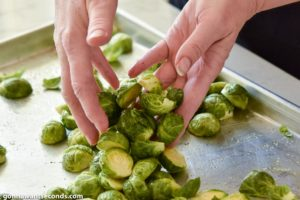 How to make Cheesy Roasted Brussels Sprouts, coating with oil