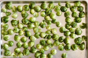 How to make Cheesy Roasted Brussels Sprouts, arranging on a baking sheet