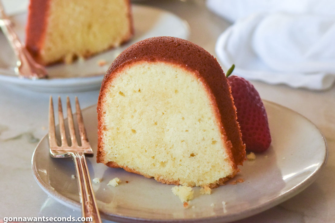 A slice of Old Fashioned Pound Cake on a plate