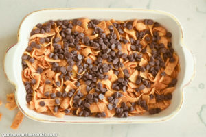 How to make Frito Bars, adding chocolate chips on top of the Fritos layer