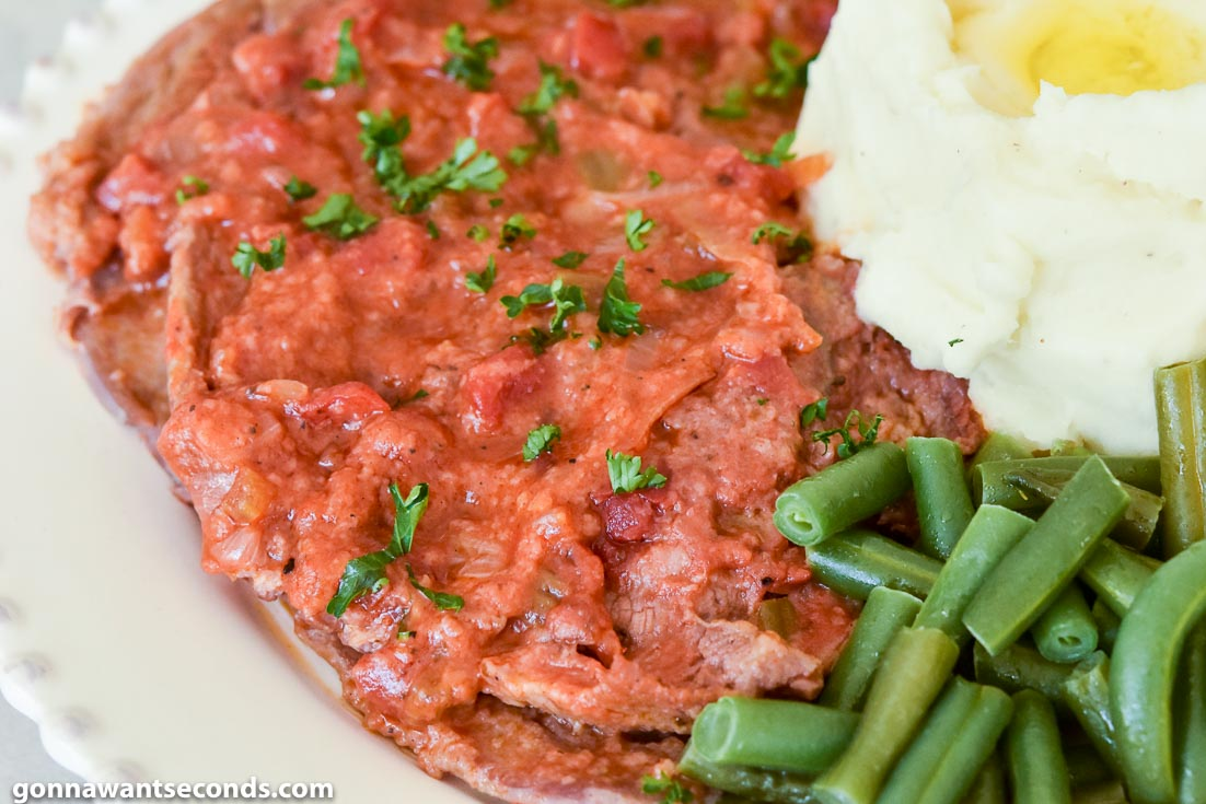 Swiss Steak with mashed potato and green beans on the side