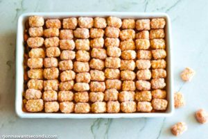 How to make Cowboy Casserole, topping tater tots and baking