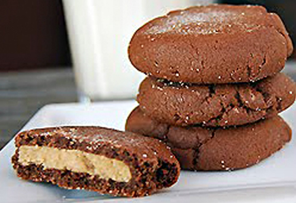 Magic Middle Peanut Butter Cookies stack on top of each other.