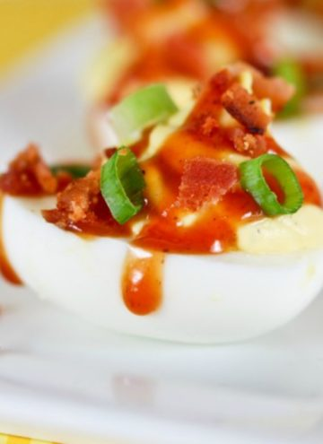 Barbecued Ranch Deviled Eggs on a rectangular serving plate