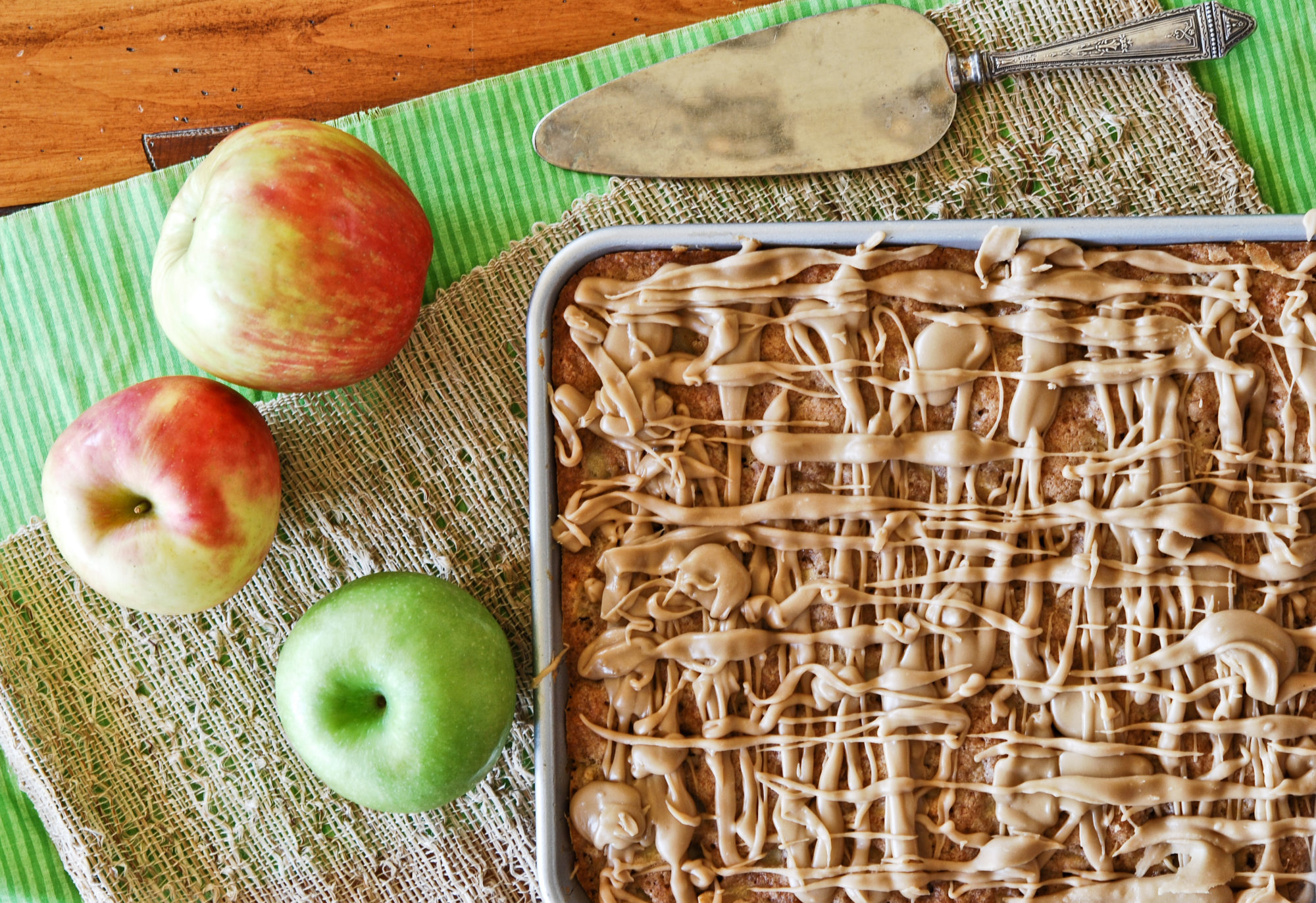 Apple Bars in a baking sheet with caramel glaze on top