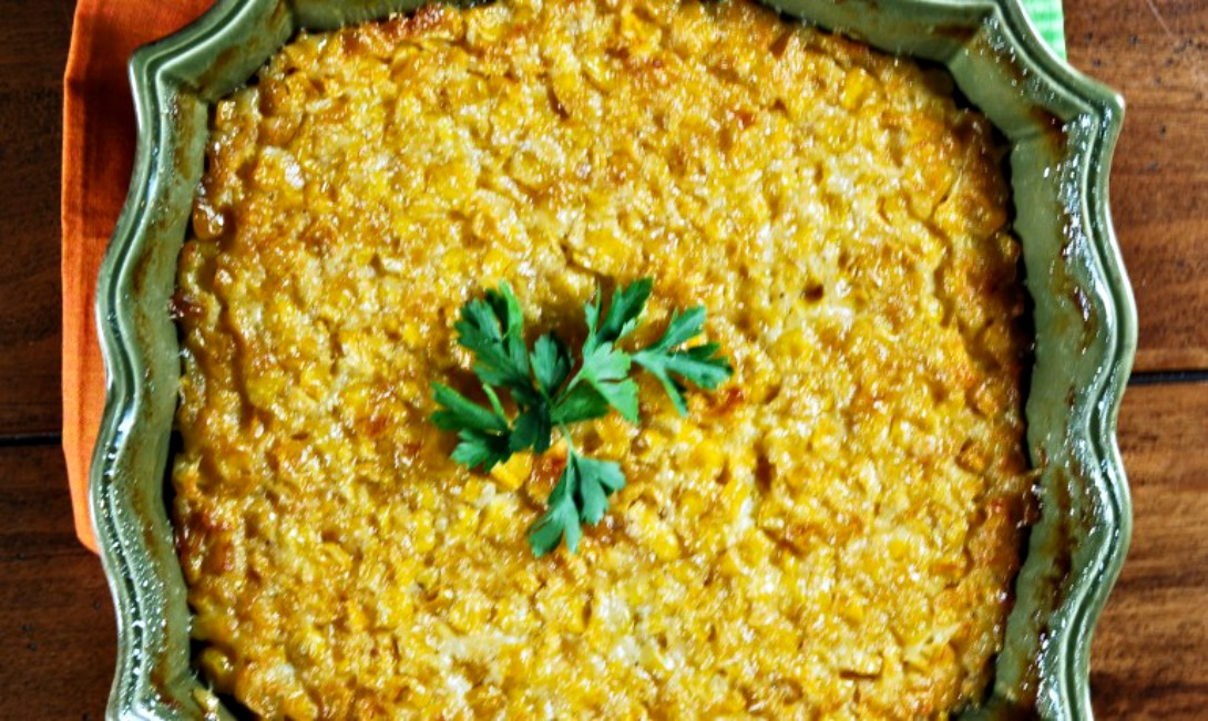 Sweet Corn Casserole in a green 8x8 baking dish