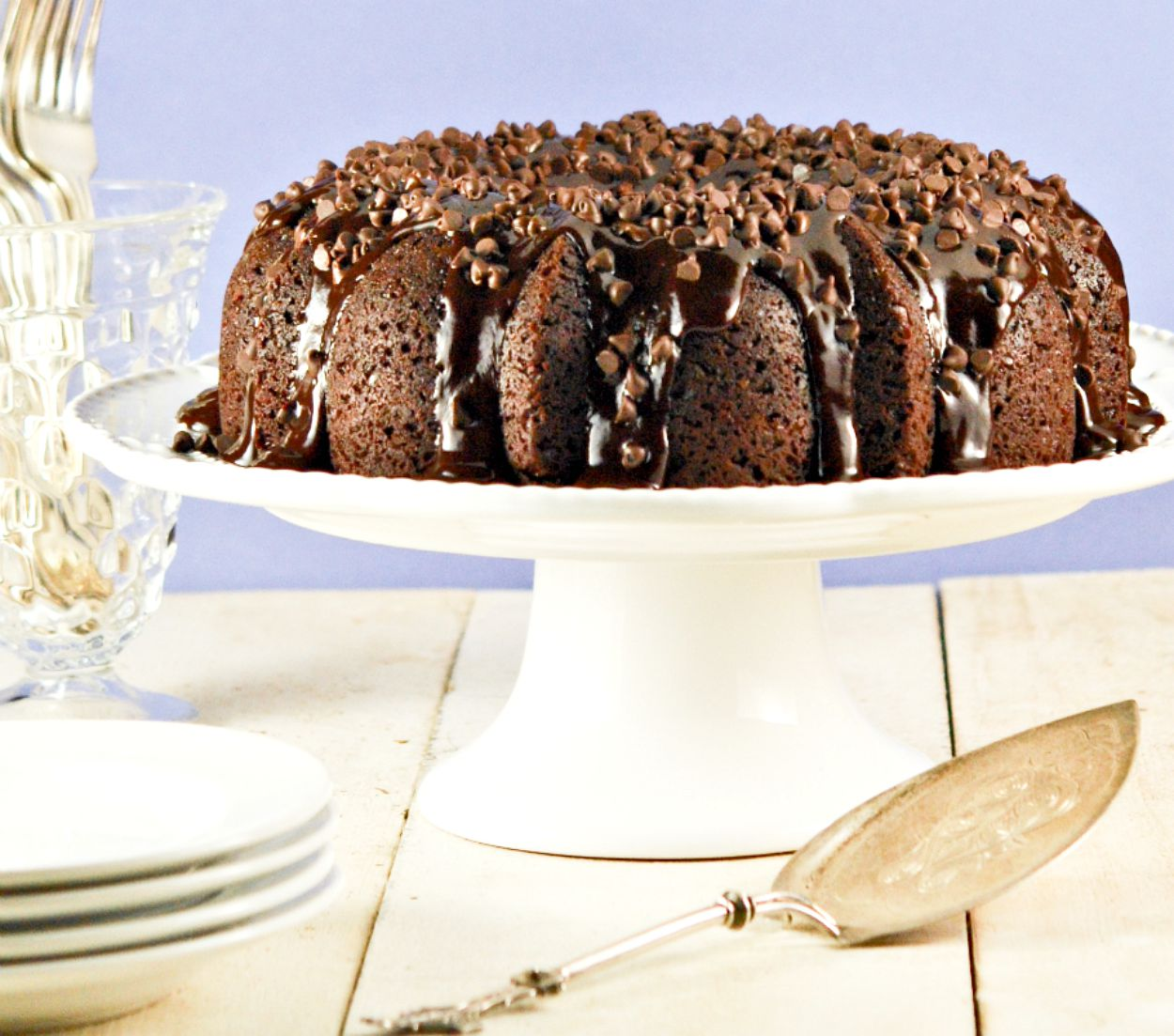 Chocolate Chocolate Chip Cake on a cake stand