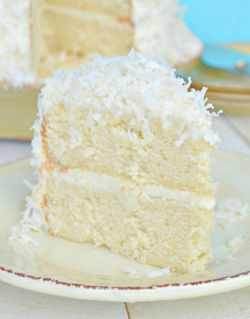 White Cake With White Frosting And Coconut