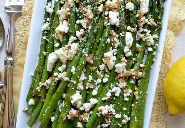 Our Roasted Garlic Asparagus with Feta Is Tossed In A Garlic Lemon Marinade And Roasted To Caramelize Flavors In The Asparagus Then Topped With Feta!
