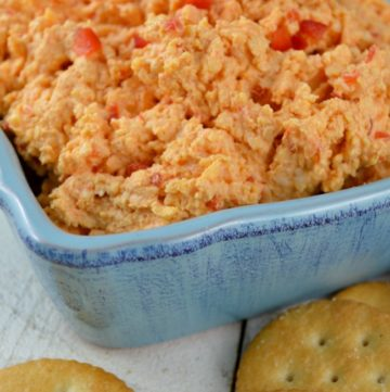 Pimento Cheese in a blue bowl with crackers on the side