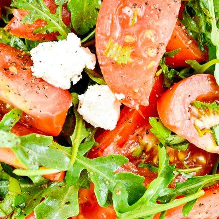 Marinated Tomato Salad on a white rectangular platter