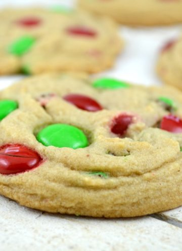 Soft Batch Christmas M&M Cookies on a white wooden table