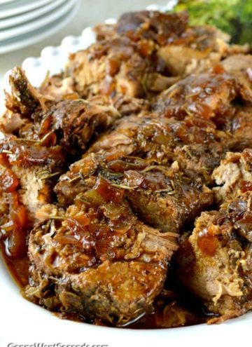 Crock Pot Pork Tenderloin in a white serving dish