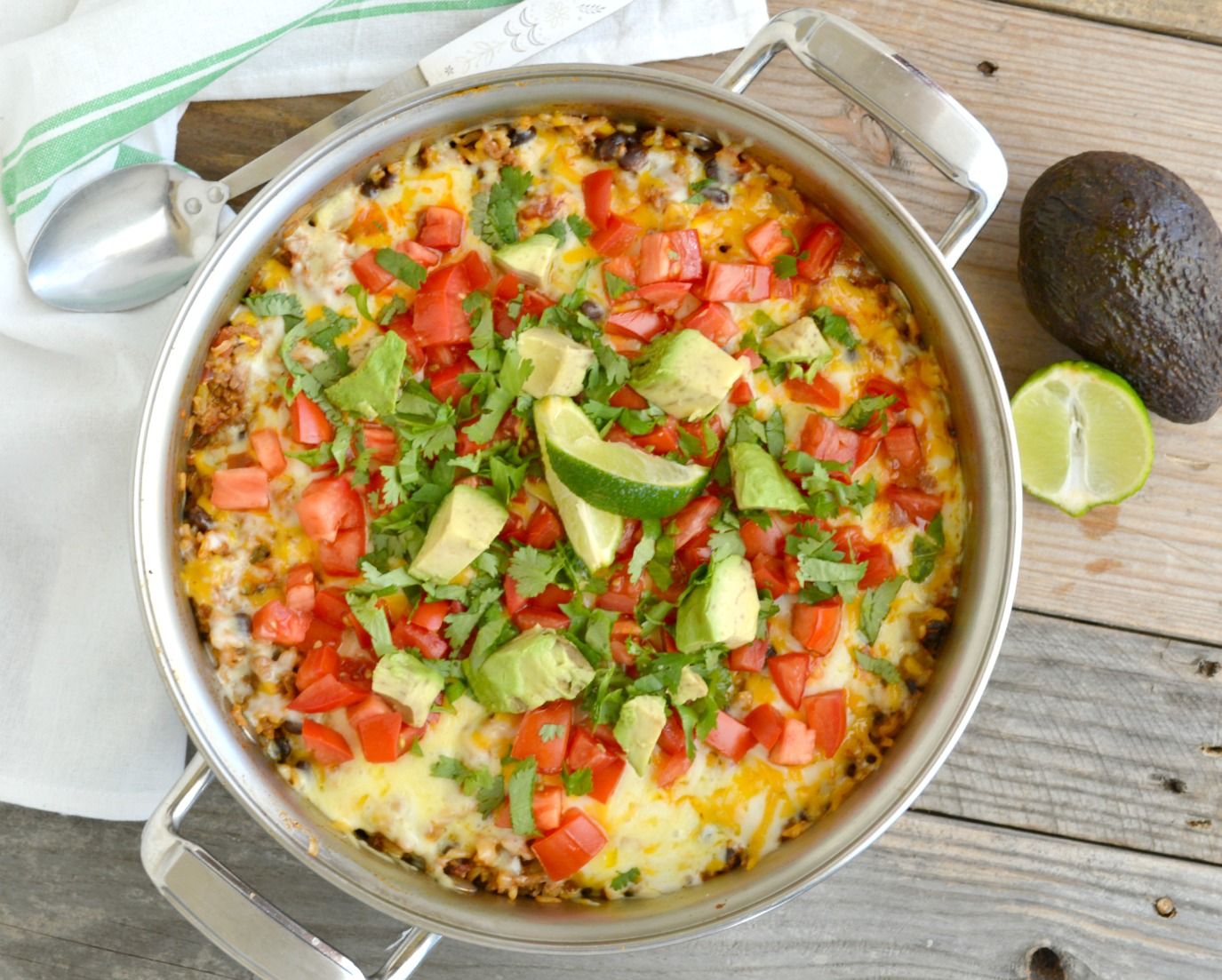 One Pot Burrito Bowl topped with chopped avocados and tomatoes in a pot