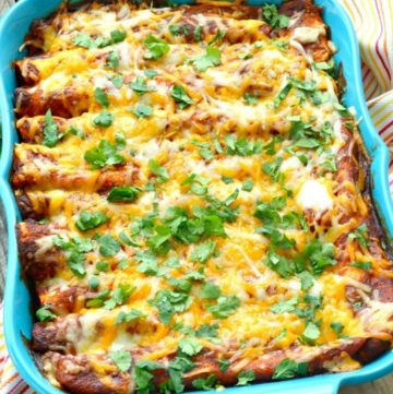Cheesy chicken enchiladas recipe in a blue casserole dish
