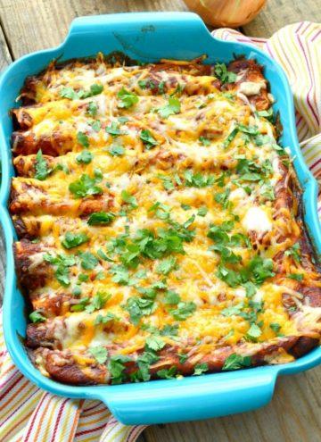 Cheesy chicken enchiladas recipe in a blue casserole dish