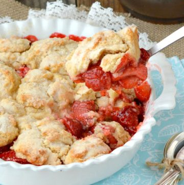 Whole Strawberry Cobbler with a closer shot of spoonful of cobbler