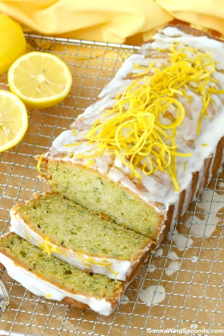 Whole Lemon Zucchini Bread with glaze on a cooling rack