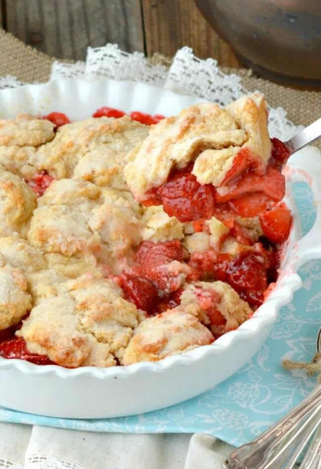 Fresh Strawberry Cobbler is unique and delicious cobbler made with fresh strawberries crowned with a cakey topping that has a lovely hint of lemon flavor. Easy and quick to put together.