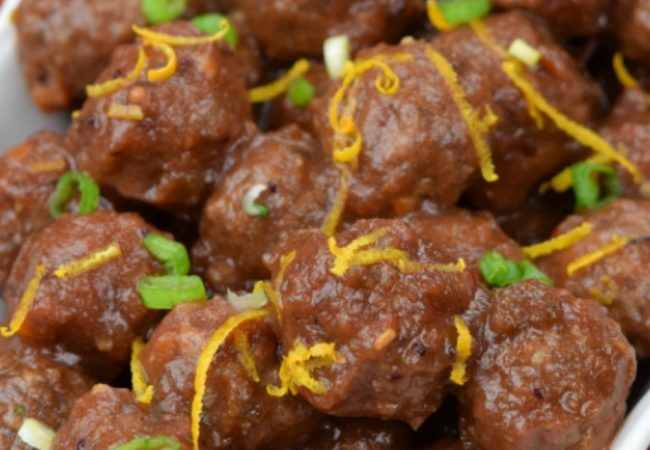 Cranberry Meatballs in a rectangle white serving dish