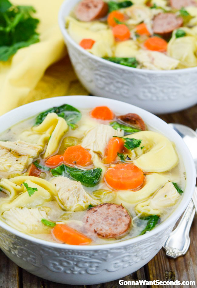 Two Chicken Tortellini Soup in white bowls