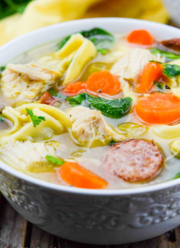 Chicken Tortellini Soup in a white bowl
