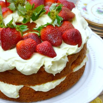 Strawberry Cream Cake on a white cake stand