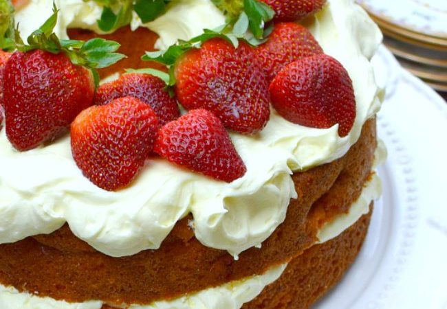 Strawberry Cream Cake on a white cake stand
