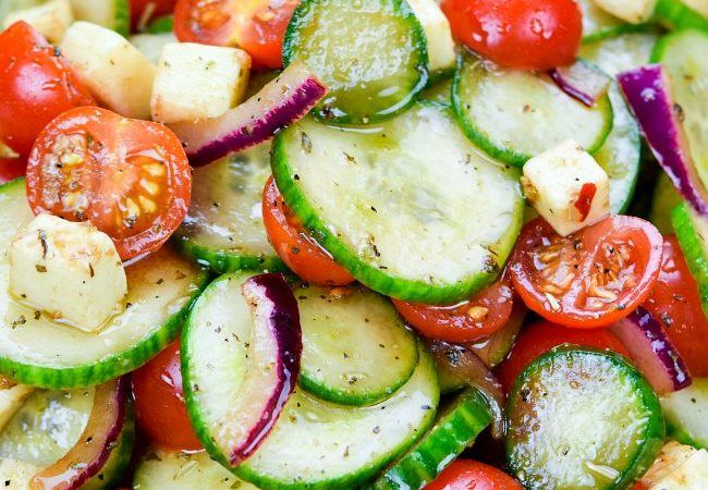 Cool off with my Cucumber Tomato Salad, a crisp, colorful, refreshing side with salty bits of mozzarella and a rich, tangy balsamic vinaigrette.  A delicious dish full of garden delights! #CucumberTomatoSalad #CucumberSalad #saladrecipe #tomatocucumbersalad #tomatosalad #easysaladrecipes #sidedish #salad