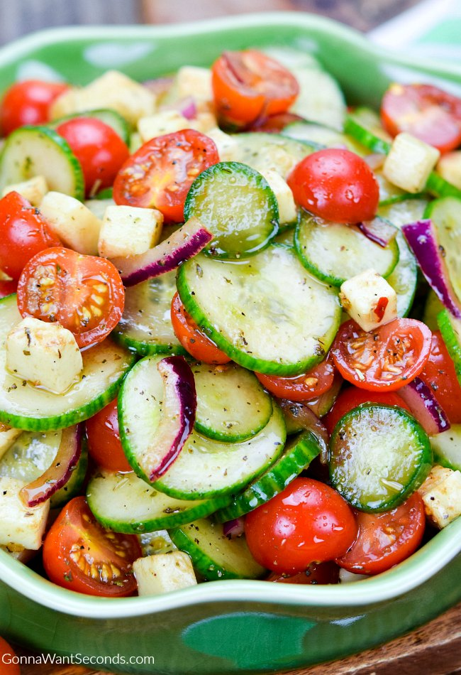 Cucumber Tomato Salad in a shallow green dish