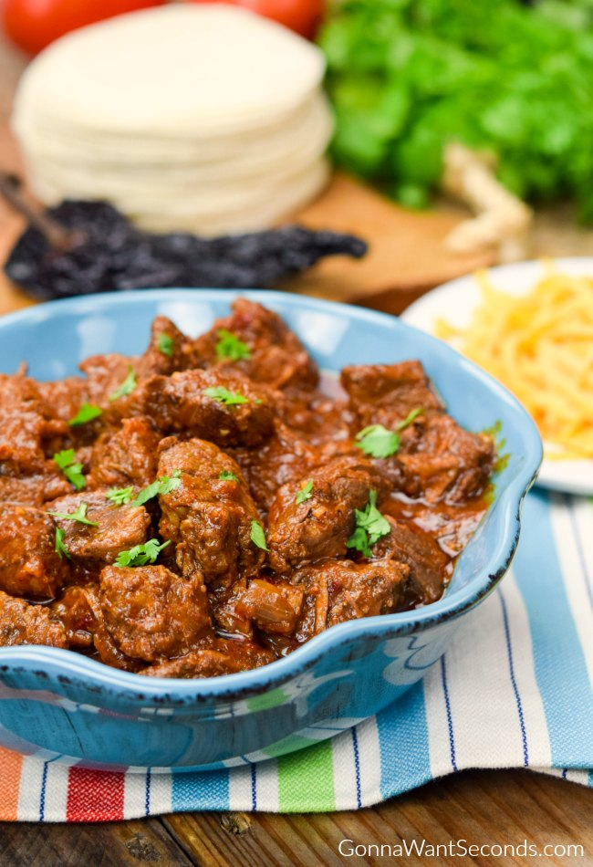 Carne Guisada- deliciously cooked chunks of beef in a chile, cumin, tomato gravy