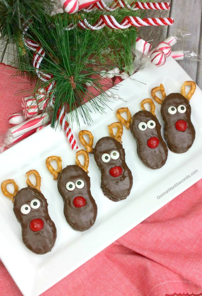 Reindeer Nutter Butter Treats on a serving plate, with Christmas decorations around