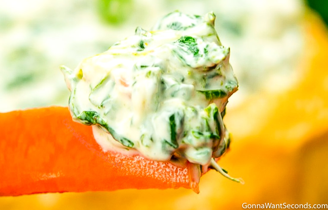 Knorr Spinach Dip on the tip of a carrot stick