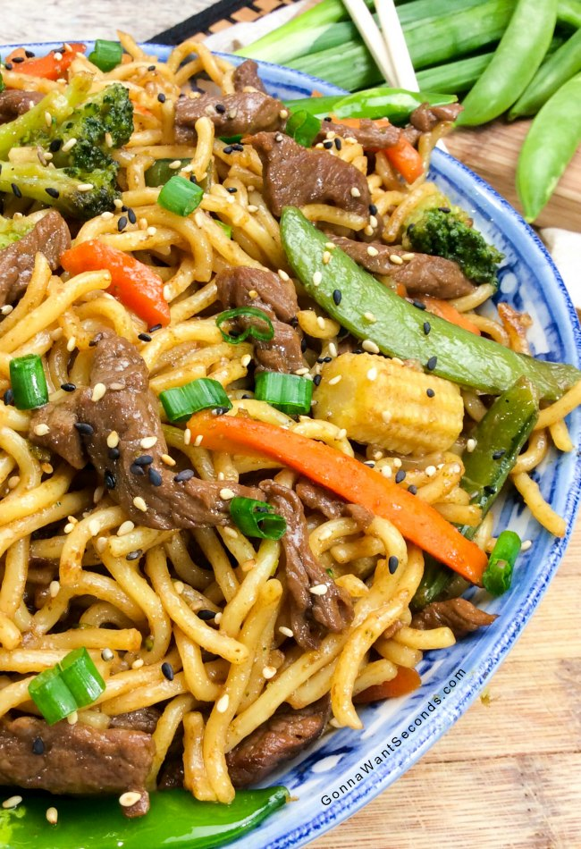 Easy beef chow mein recipe our recipe is quick easy and delish beef chow mein in a blue bowl forumfinder Images
