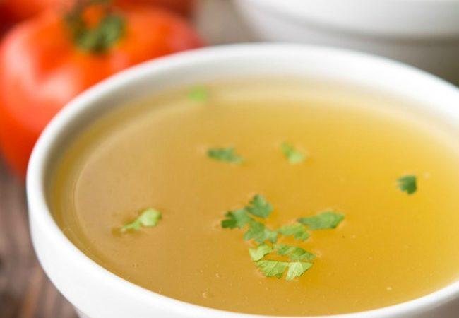 Caldo de Pollo in white soup bowl