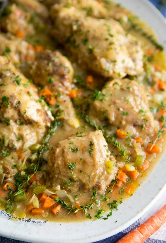 Smothered Chicken on a large white oval platter