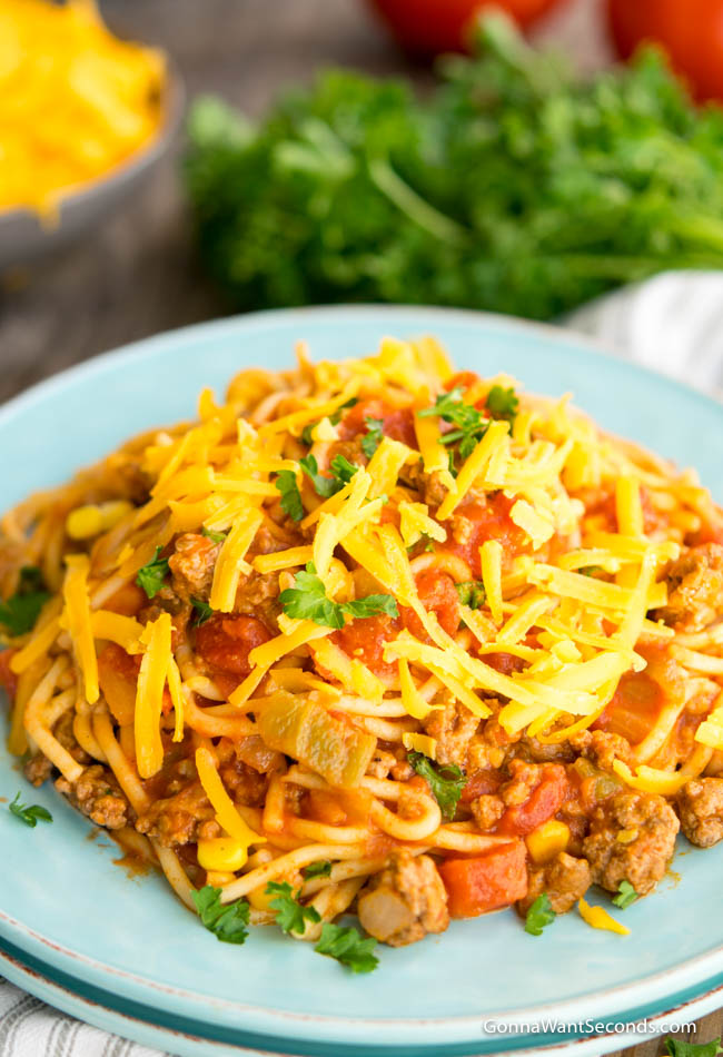 Mexican Spaghetti topped with shredded cheese and parsley