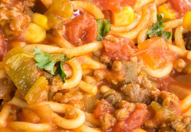 Close up of Mexican Spaghetti on a blue plate