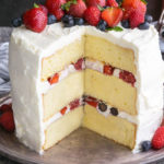 Berry Chantilly Cake on a gray cake plate