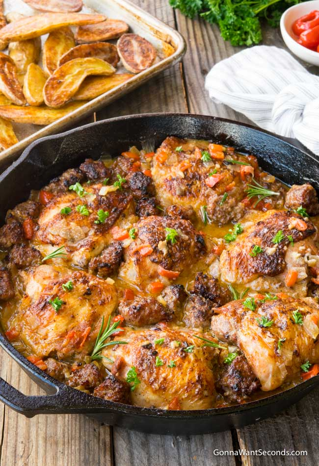 Chicken Scarpariello in a cast iron skillet.