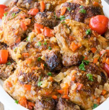Chicken Scarpariello on a white oval platter.