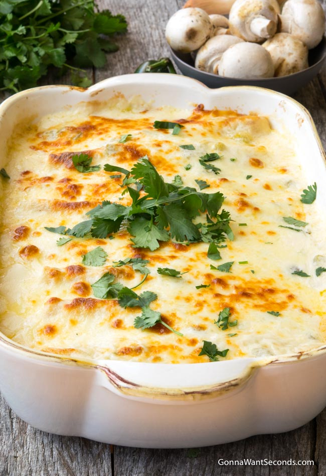 Creamy Shrimp Enchiladas in a white casserole dish