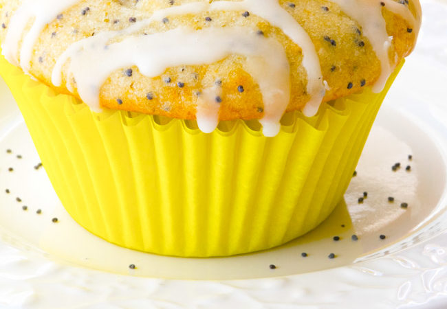 Lemon Poppy Seed Muffins on a white plate.