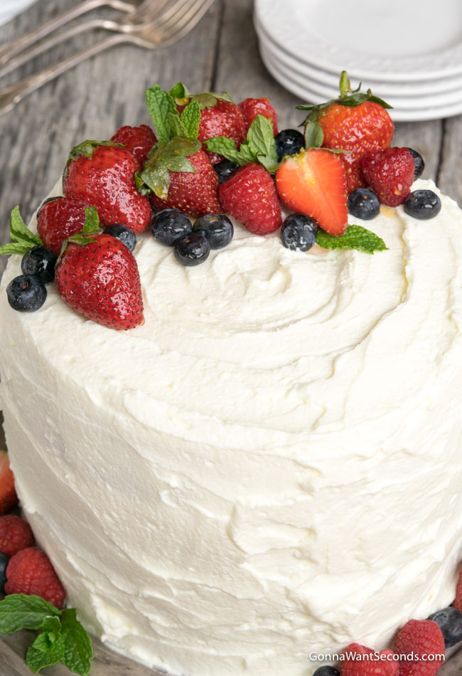 whole Berry Chantilly Cake on a gray cake plate