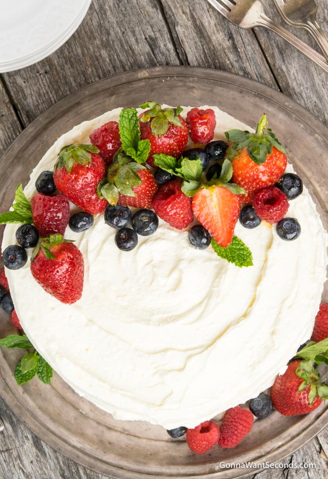 whole Berry Chantilly Cake on a gray cake plate, top shot