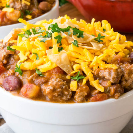 Taco Chili topped with shredded cheese in a white bowl